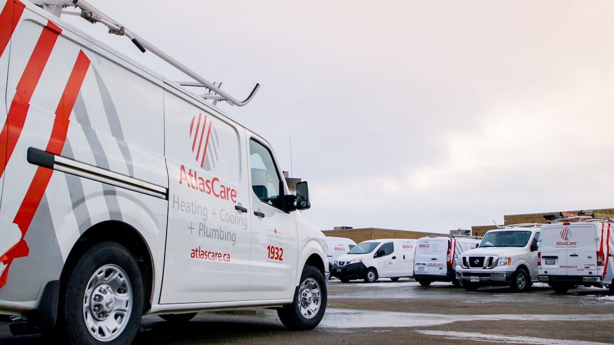 white atlas care vans parked with grey sky