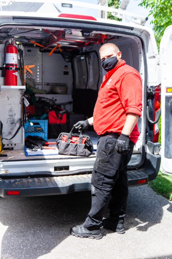 AtlasCare technician removing equipment from a service truck